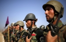 Afghan National Army officers stand at attention during a training exercise in Afghanistan