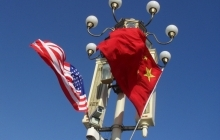 China and US flags hung on lampost