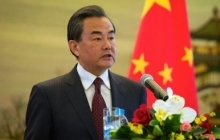 Chinese Foreign Minister Wang Yi Addresses Reporters as Secretary Kerry Listens