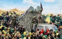 Hezbollah members and supporters attend the funeral of three fighters