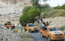 armed motorcade belonging to members of Derna's Islamic Youth Council drives along a road in the town of Derna in eastern Libya