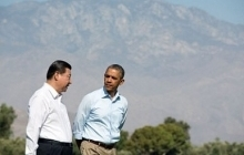 Obama walking with President Xi