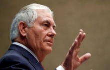 U.S. Secretary of State Rex Tillerson gestures while speaking to staff members at the U.S. Mission to the U.N. in Switzerland