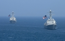 USS Lassen (left) during a joint Republic of Korea-United States military exercise. U.S. Navy Photo by John J. Mike (CC BY)