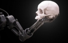 skull held by robotic arm