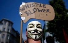 Individual protesting for the rights of whistle blowers