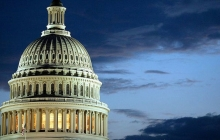 The US Capitol Dome, with a background of dark skies