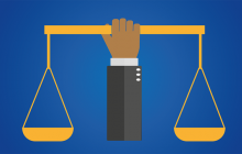 A clipart-like image with a human arm seving as the base for a set of scales; the hand grasps the bar that connects the balances