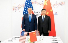 Donald Trump and Xi Jinping stand next to one another