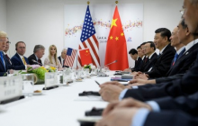 Donald Trump and his team sit across a table from Xi Jinping and his team