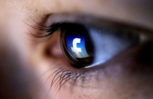 Eye with Facebook icon reflection