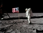 Man on the moon with US flag