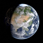 Earth, partially in shadow, against a black background