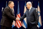 Mike Pompeo and Benjamin Netanyahu shake hands