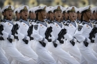 Soldiers from China's People's Liberation Army's Navy march in formation during a 2019 parade and yell