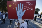 "Someone holds a ""Stop China"" sign at an October 1 protest in the Uighur community in Istanbul"