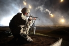 Sgt. Larry J. Isbell, representing the National Guard, watches his firing lane for targets. This photo is copyrighted by the U.S